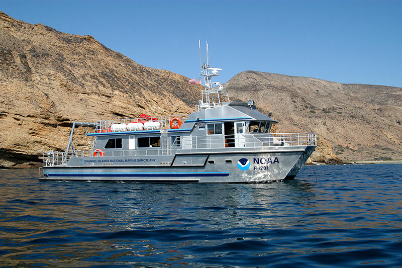A NOAA research vessel next to Santa Cruz Island